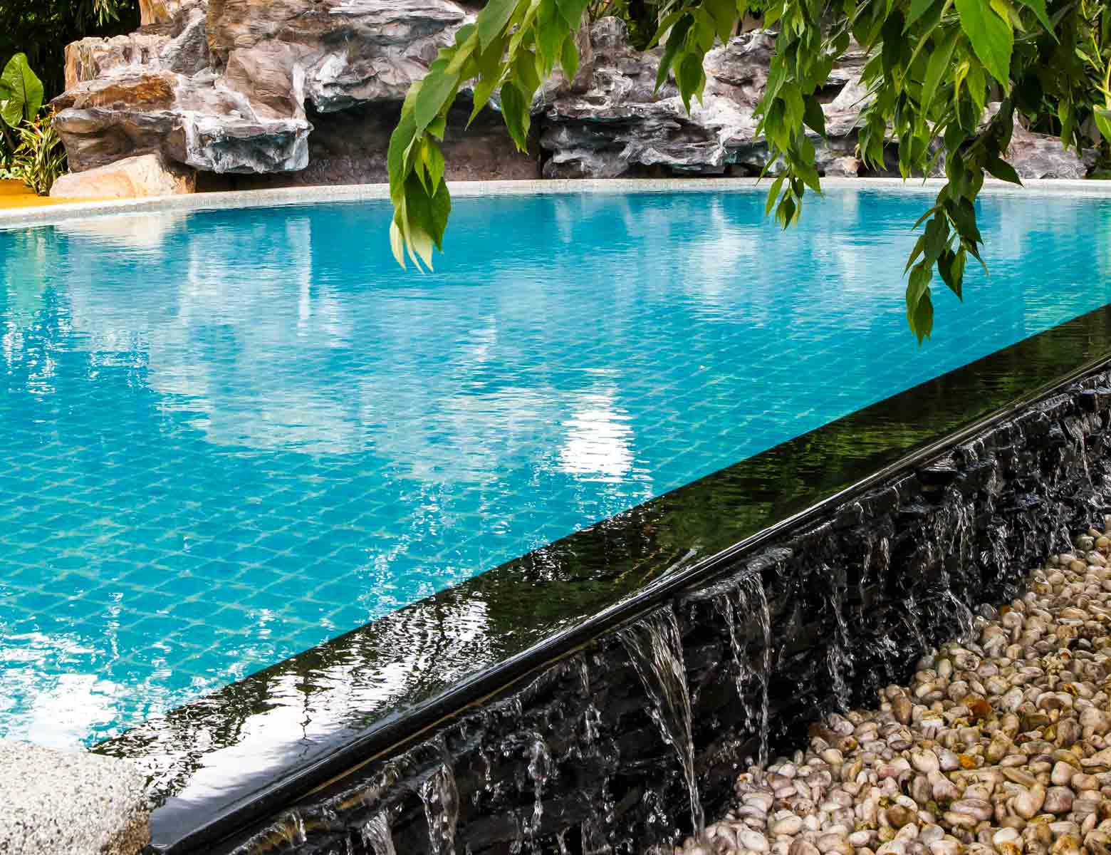 The salt water pool and waterfall at Mala Dhara Eco Resort in Doi Saket area of Chiang Mai Thailand.