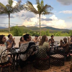 retreat group having dinner on veranda enjoying view of rice fields in Chiang Mai
