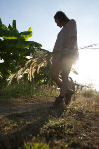 walking the organic farm to inspect the rice berries in Chiang Mai at Mala Dhara Yoga Retreat Center